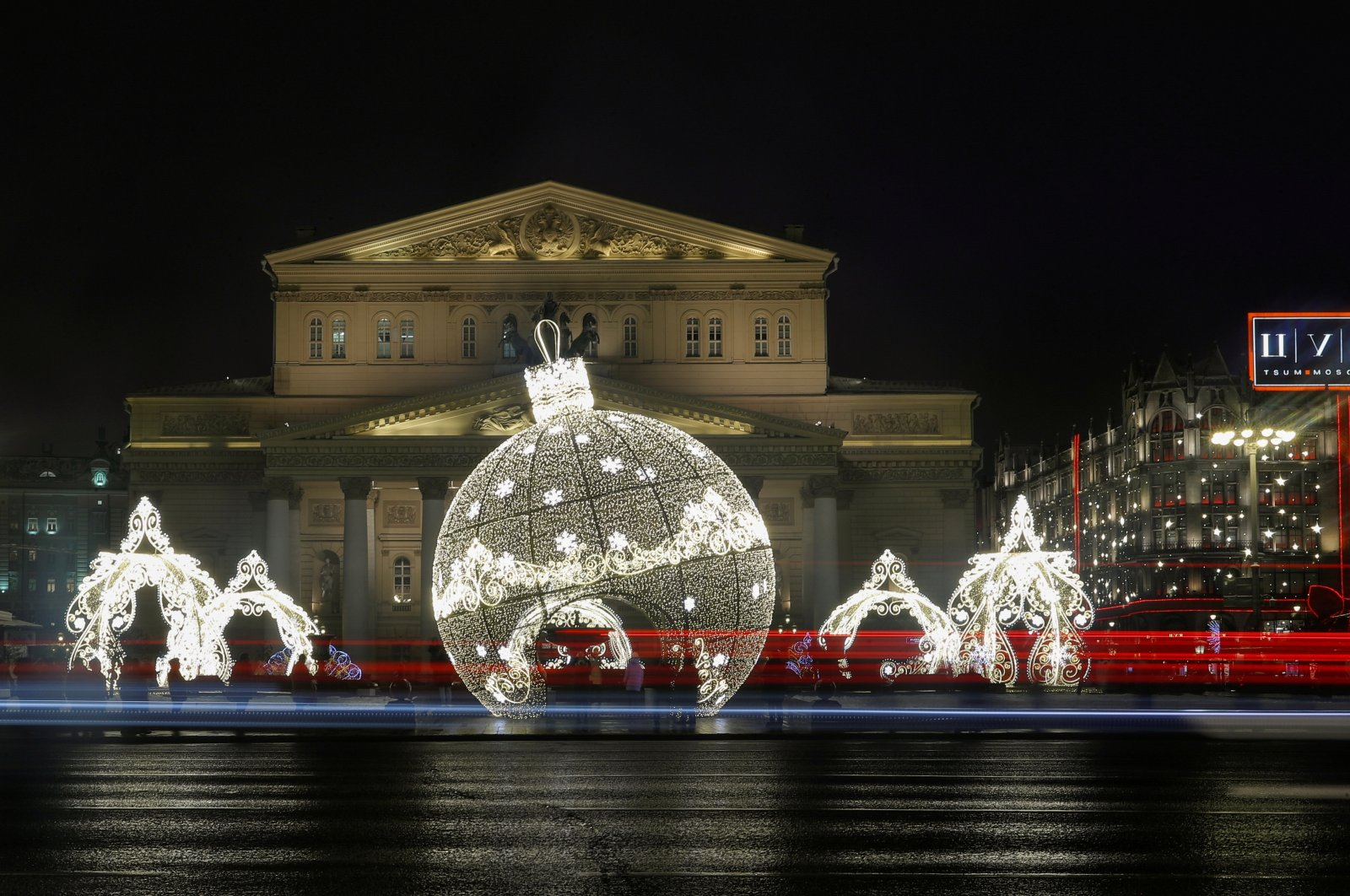 Traffic flows past the New Year and Christmas season decorations in front of the Bolshoi Theatre in Moscow, Russia, Dec. 16, 2020. (Reuters Photo)
