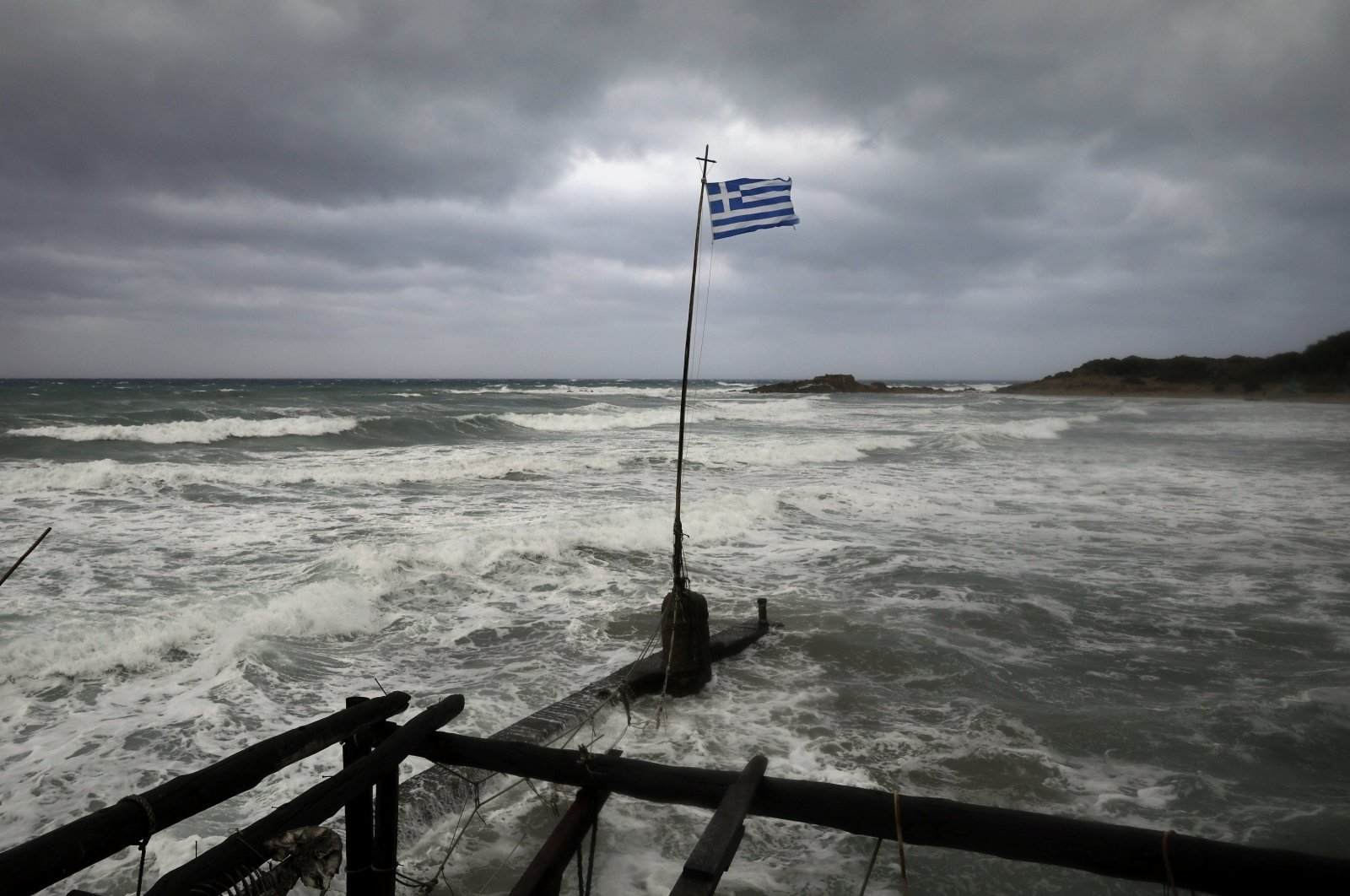A Greek flag flutters on a beach near the town of Kyllini, as a rare storm, known as a Medicane (Mediterranean hurricane), hits western Greece, Sept. 18, 2020. (Reuters Photo)