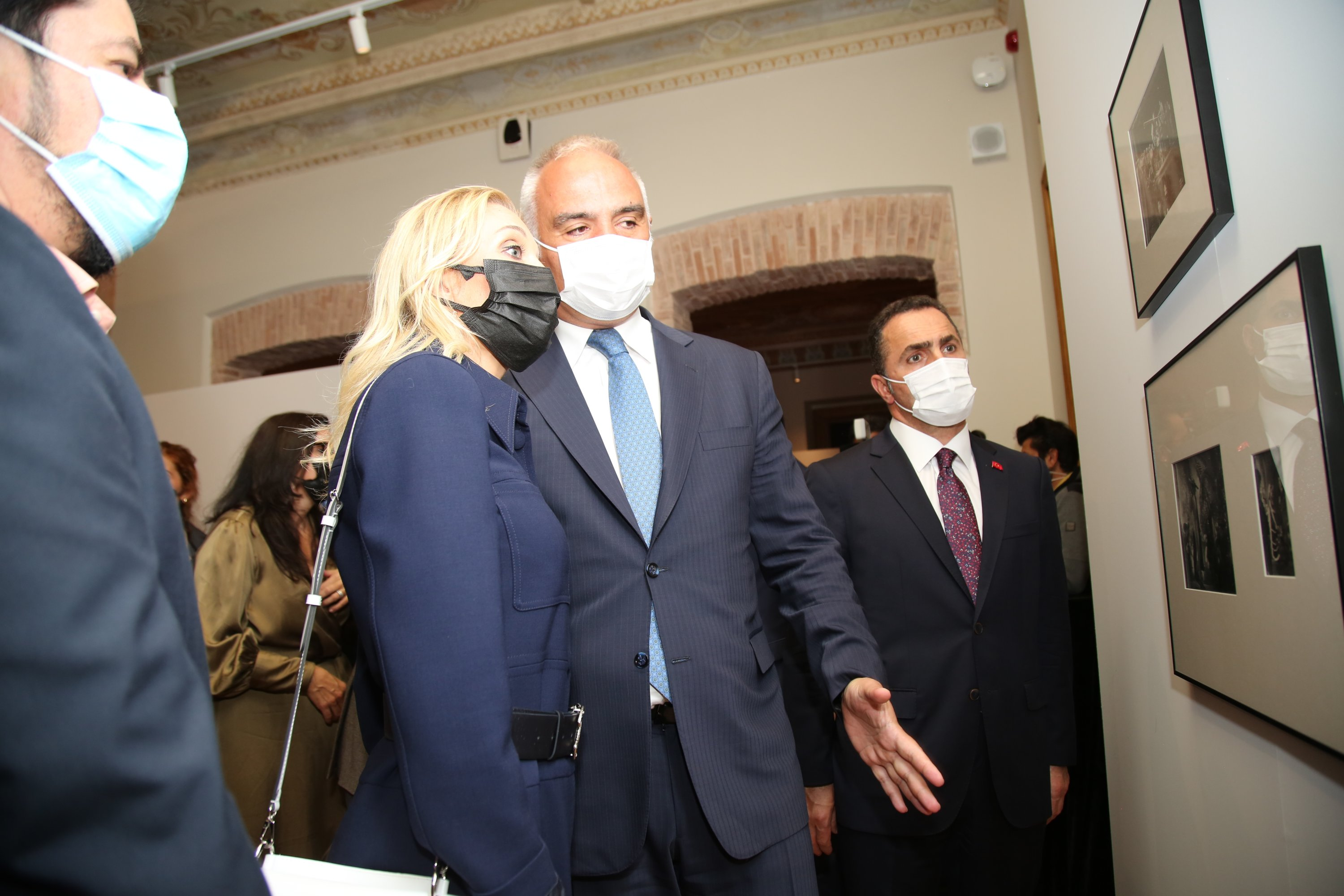 Minister of Culture and Tourism Mehmet Nuri Ersoy (C-R) and his wife Pervin Ersoy (C-L) walk through the 'Nazarin' exhibition at the Istanbul Cinema Museum, in Istanbul, Turkey, Oct. 8, 2021.