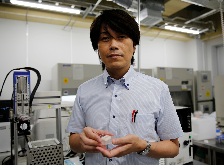 Osaka University professor Michiya Matsusaki shows off cultured Wagyu beef at a lab at the university in Suita, Osaka Prefecture, Japan, Oct. 5, 2021. (Reuters Photo)