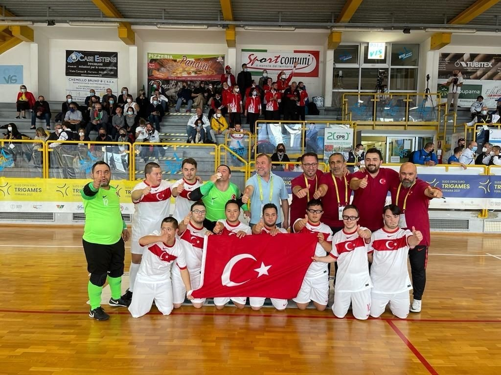 Turkey's National Futsal Team with Down Syndrome poses with the Turkish flag after beating Portugal at the Trigames in Ferrera, Italy, Oct. 10, 2021. (AA Photo)