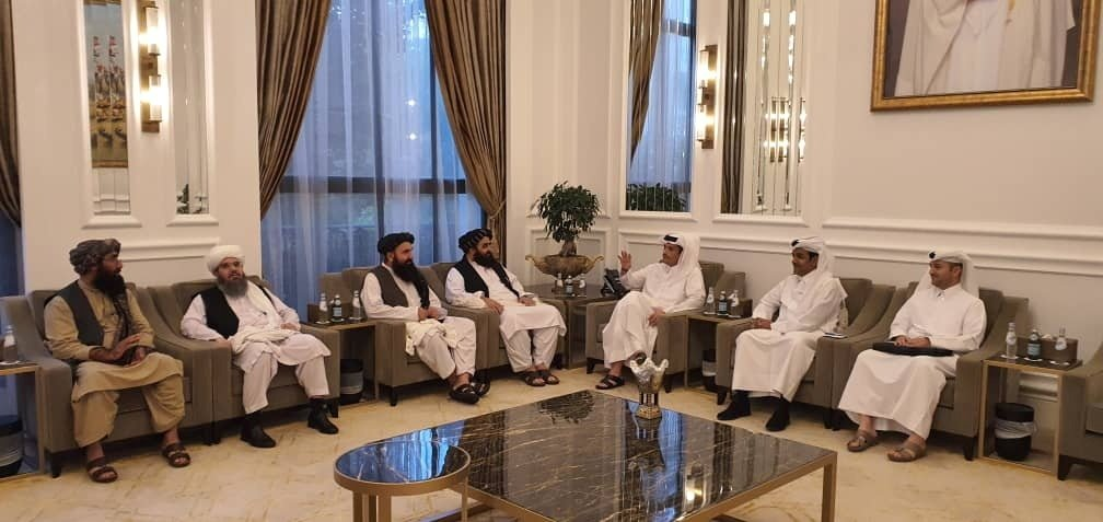 Taliban delegates meet with Qatar delegates in Doha, Qatar, in this handout photo uploaded to social media, Oct. 9, 2021. (Reuters Photo)