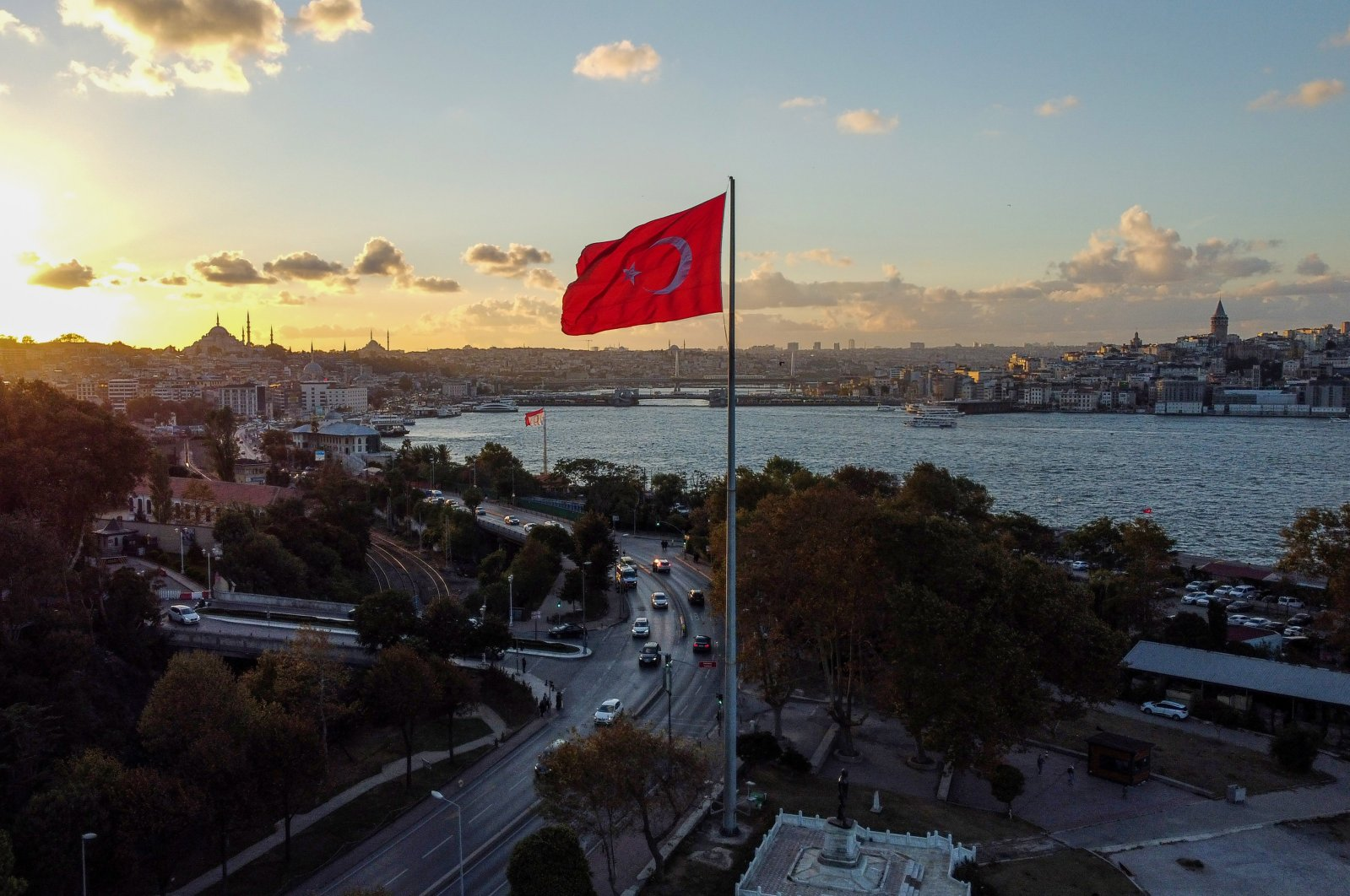 A Turkish flag by the Bosporus at the evening sunset in Istanbul, Turkey, Oct. 4, 2021. (Photo by Getty Images)