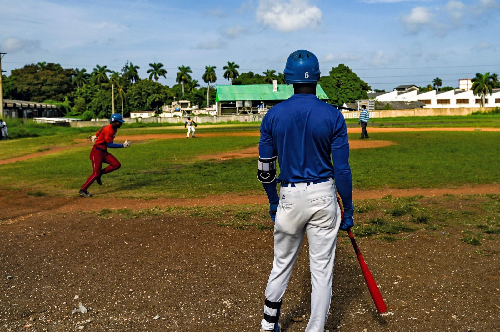 Baseball players play with friends at a field in Havana, Cuba, Oct. 7, 2021. (AFP PHOTO)