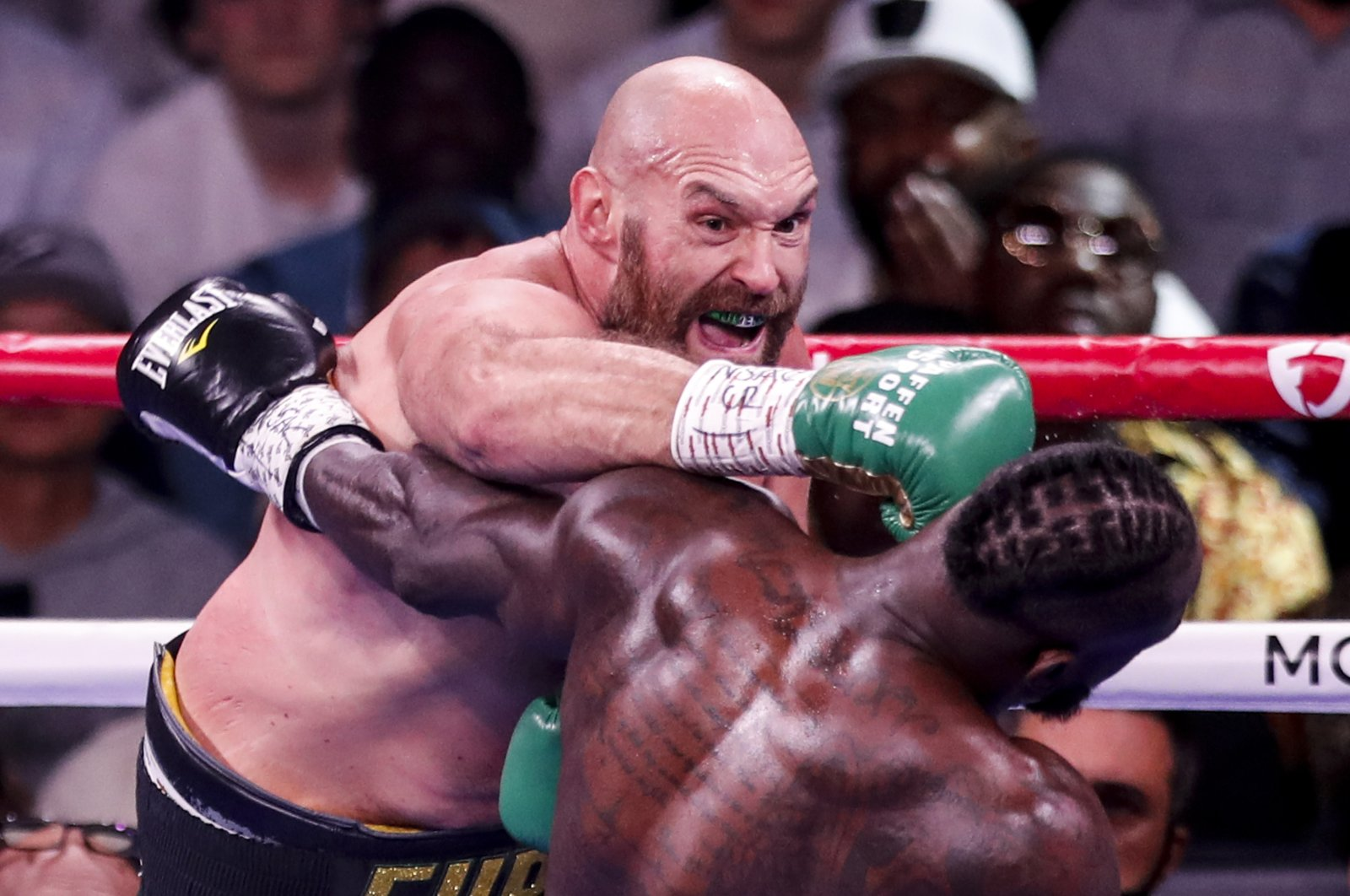 Britain's Tyson Fury (L) in action against U.S. boxer Deontay Wilder during their 12 rounds WBC heavyweight world championship title fight in Las Vegas, Nevada, U.S., Oct. 9, 2021. (EPA Photo)