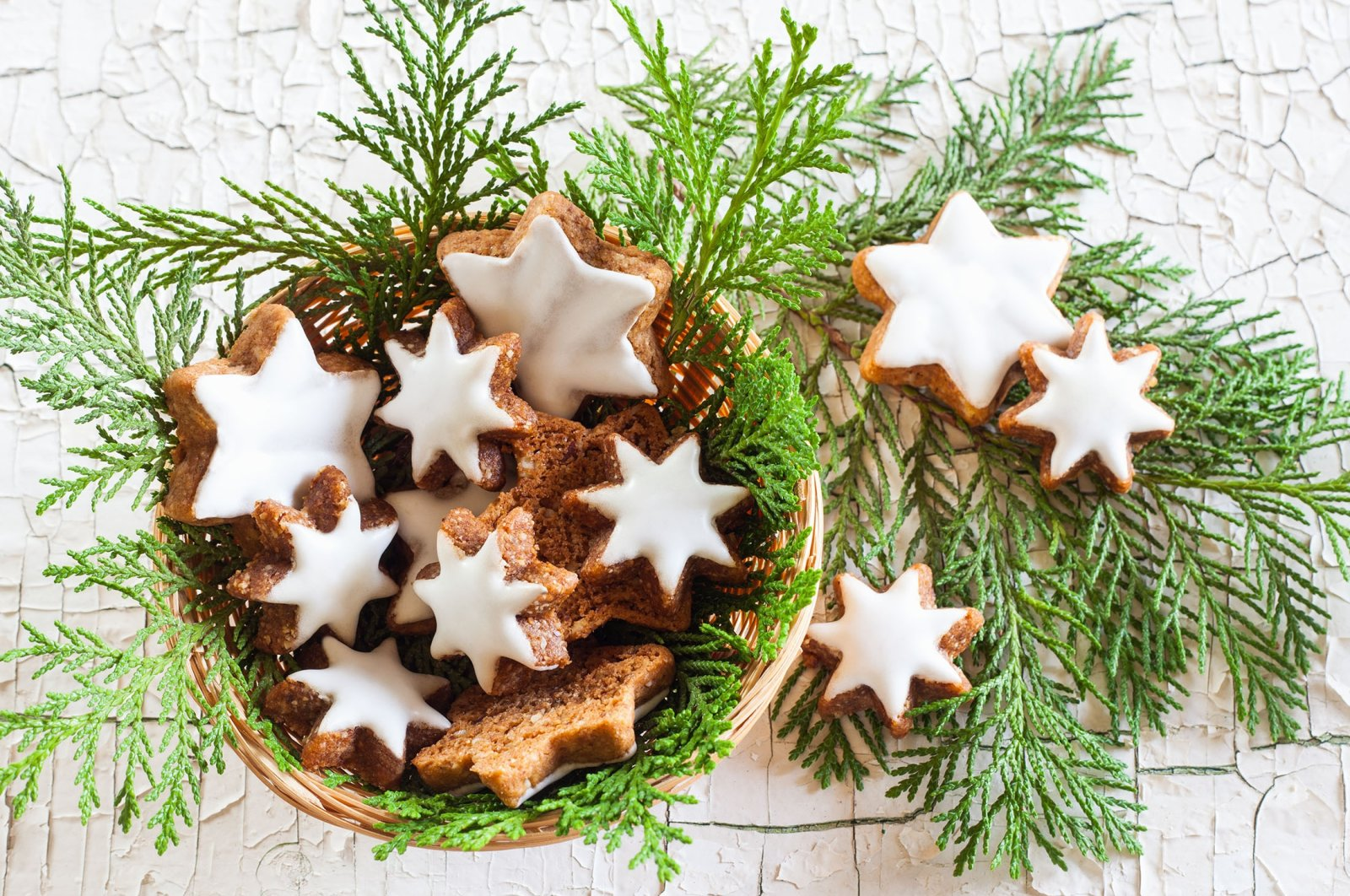 """Typical traditional German Christmas cookies called """"Zimtstern"""" that are made from almond flour, cinnamon, whipped egg white and sugar."""