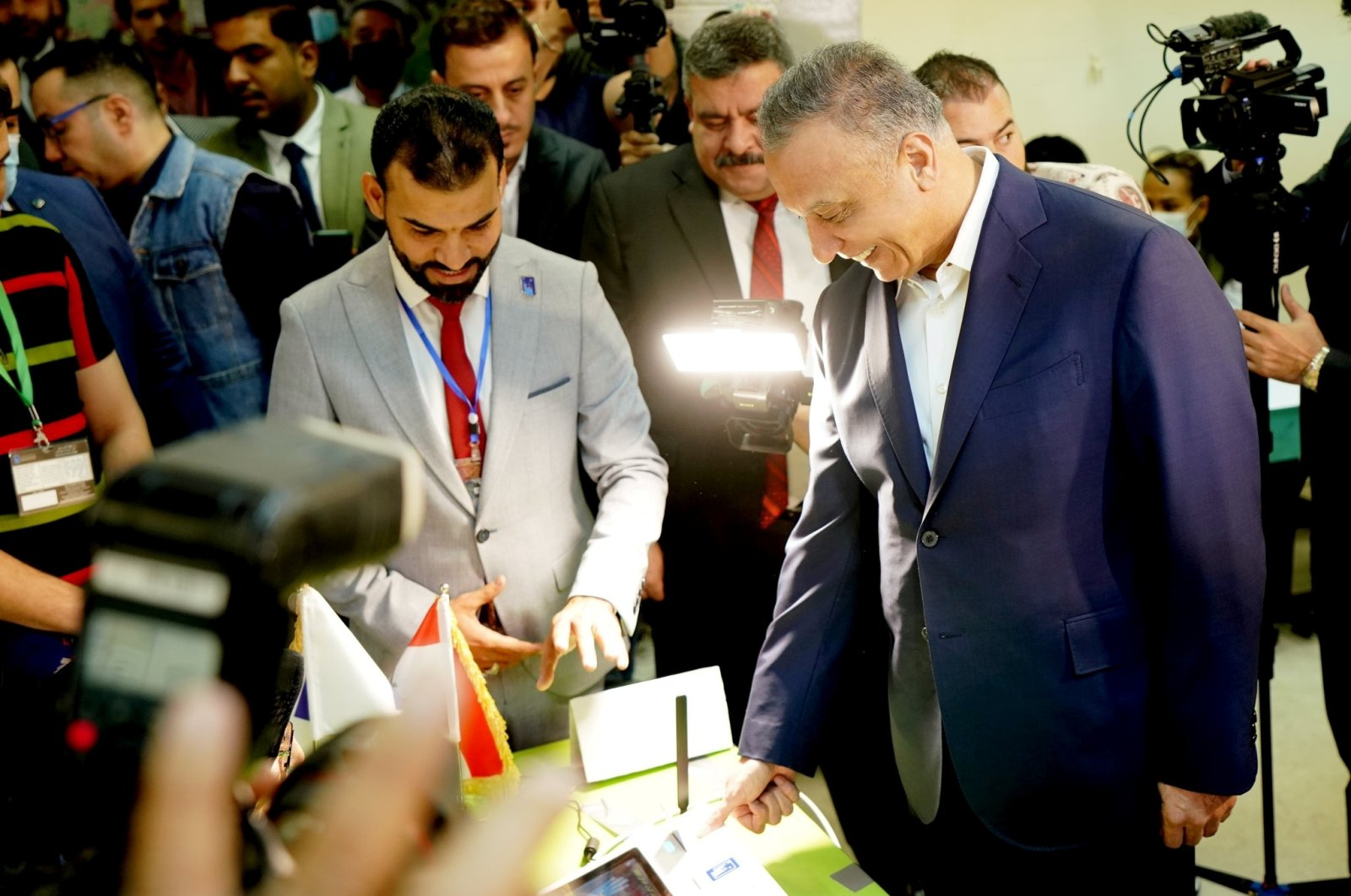 Iraqi Prime Minister Mustafa al-Kadhimi casts his vote at the polling station in the Green Zone, as Iraqis go to the polls to vote in the parliamentary election, Baghdad, Iraq, Oct. 10, 2021. (Iraqi Prime Minister Media Office via Reuters)