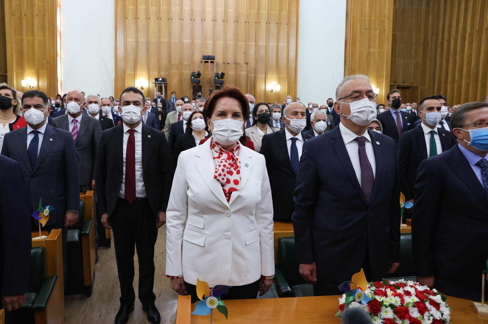 Good Party (IP) Chair Meral Akşener (C) and party officials stand during a ceremony at the Turkish Parliament, Ankara, Turkey, June 10, 2021. (AA File Photo)