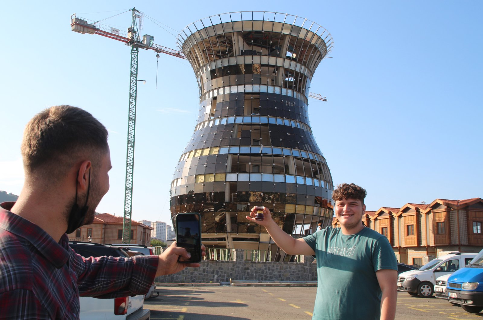 People take photos in front of the tea-glass building, in Rize, northern Turkey, Oct. 10, 2021. (DHA Photo)