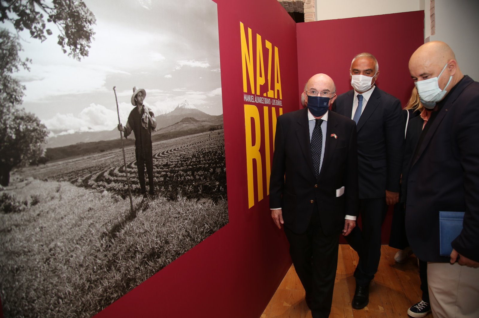 """Minister of Culture and Tourism Mehmet Nuri Ersoy (R) and the Mexican Ambassador to Ankara Jose Luis Martinez y Hermandez (L) walk through the """"Nazarin"""" exhibition at the Istanbul Cinema Museum, in Istanbul, Turkey, Oct. 8, 2021."""