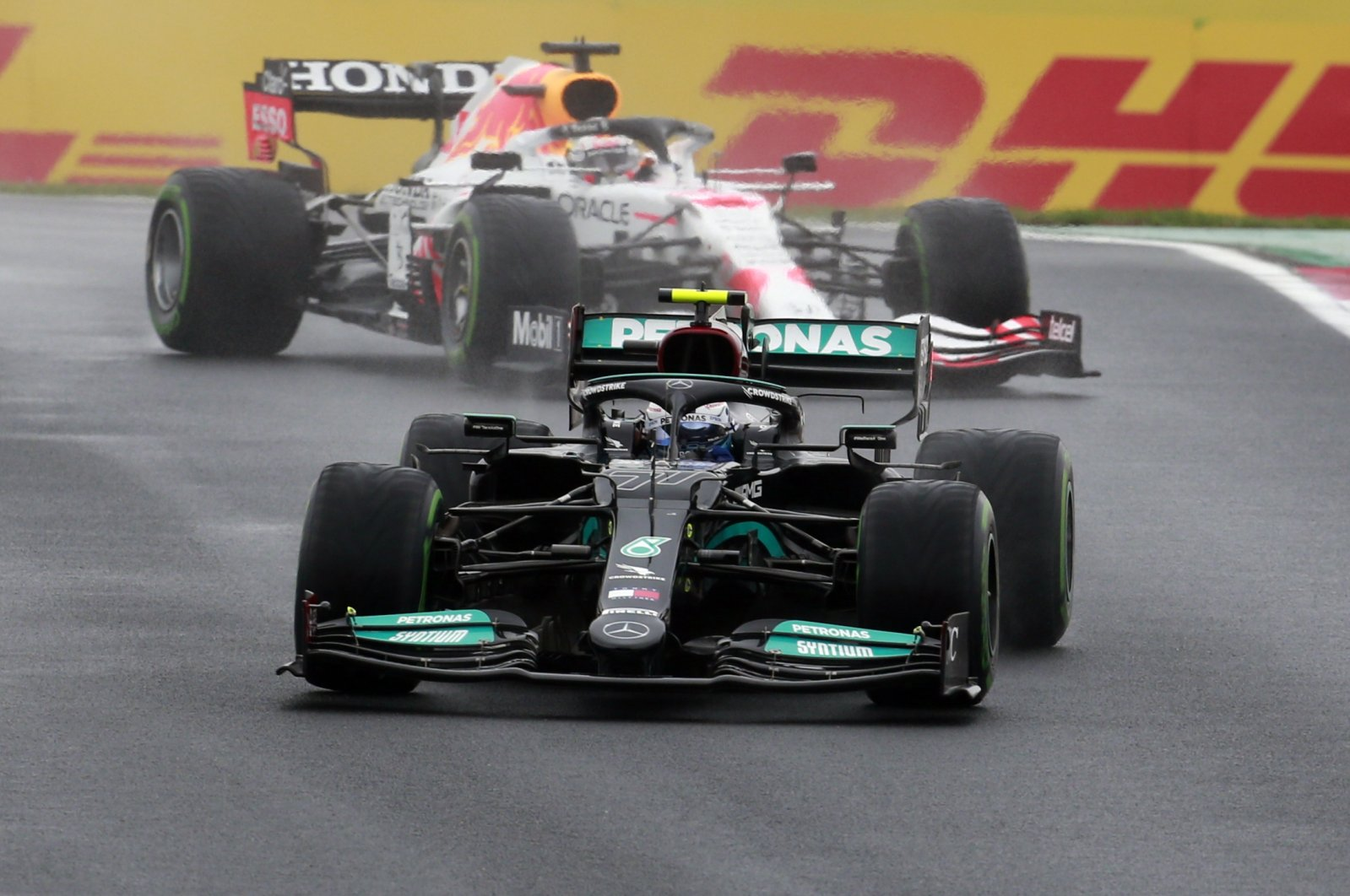Mercedes driver Valtteri Bottas of Finland steers his car followed by Red Bull driver Max Verstappen of the Netherlands during the Turkish Formula One Grand Prix at the Intercity Istanbul Park circuit in Istanbul, Turkey, Sunday, Oct. 10, 2021. (AP Photo)