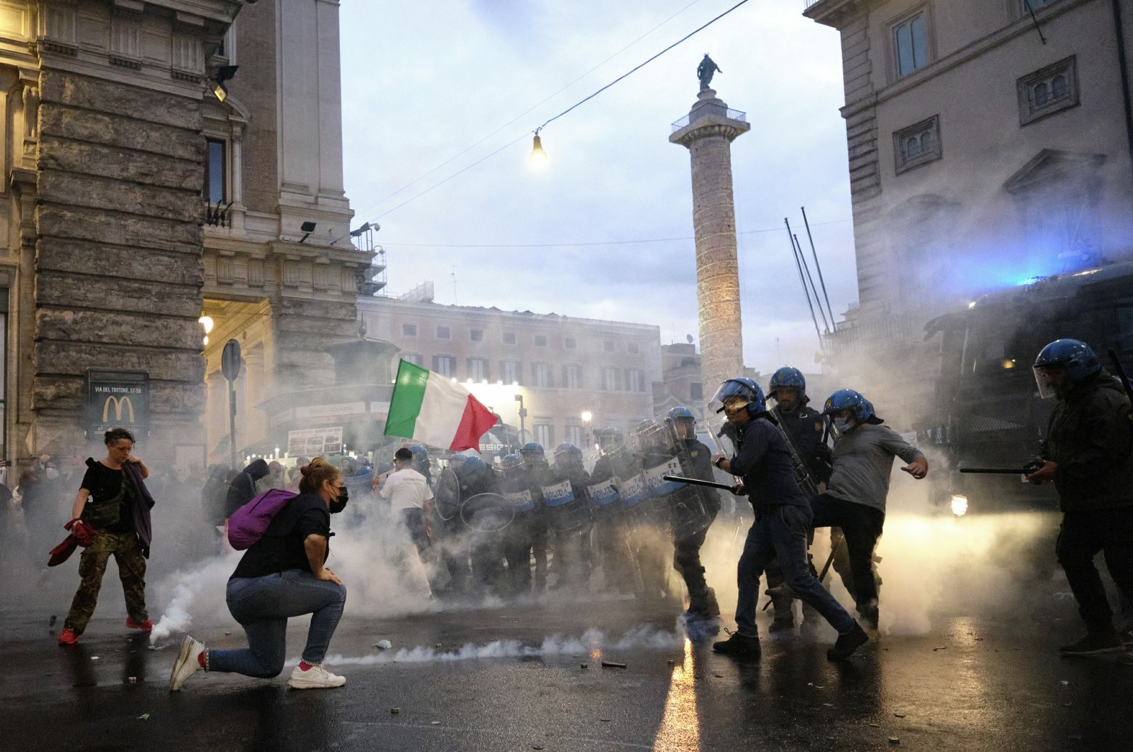 Demonstrators and police clash during a protest, in Rome, Italy, Oct. 9, 2021. (AP Photo)