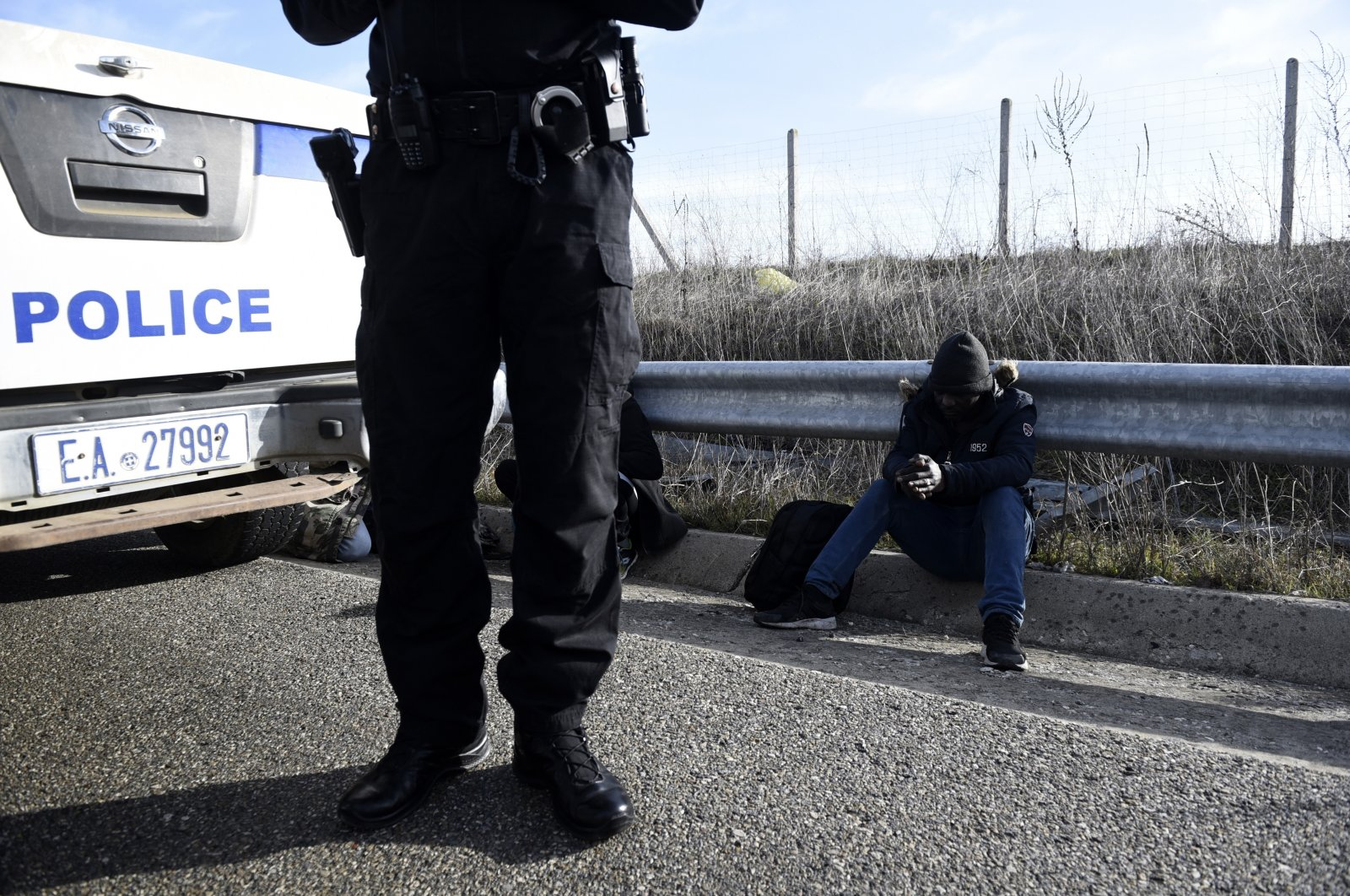 Greek police detain a migrant near the town of Orestiada, in the Evros region, at the Greek-Turkish border, March 3, 2020. (AP File Photo)