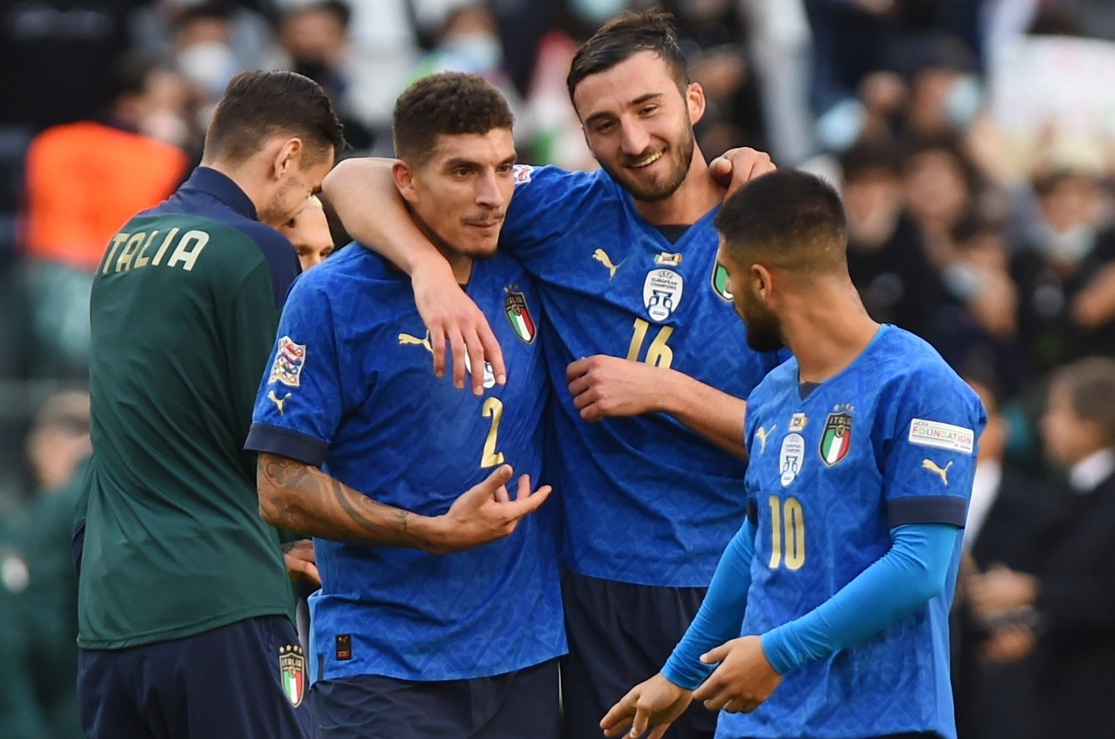Italy's Giovanni Di Lorenzo (L), Bryan Cristante (C) and Lorenzo Insigne celebrate winning the UEFA Nations League third-place playoff against Belgium, Allianz Stadium, Turin, Italy, Oct. 10, 2021.