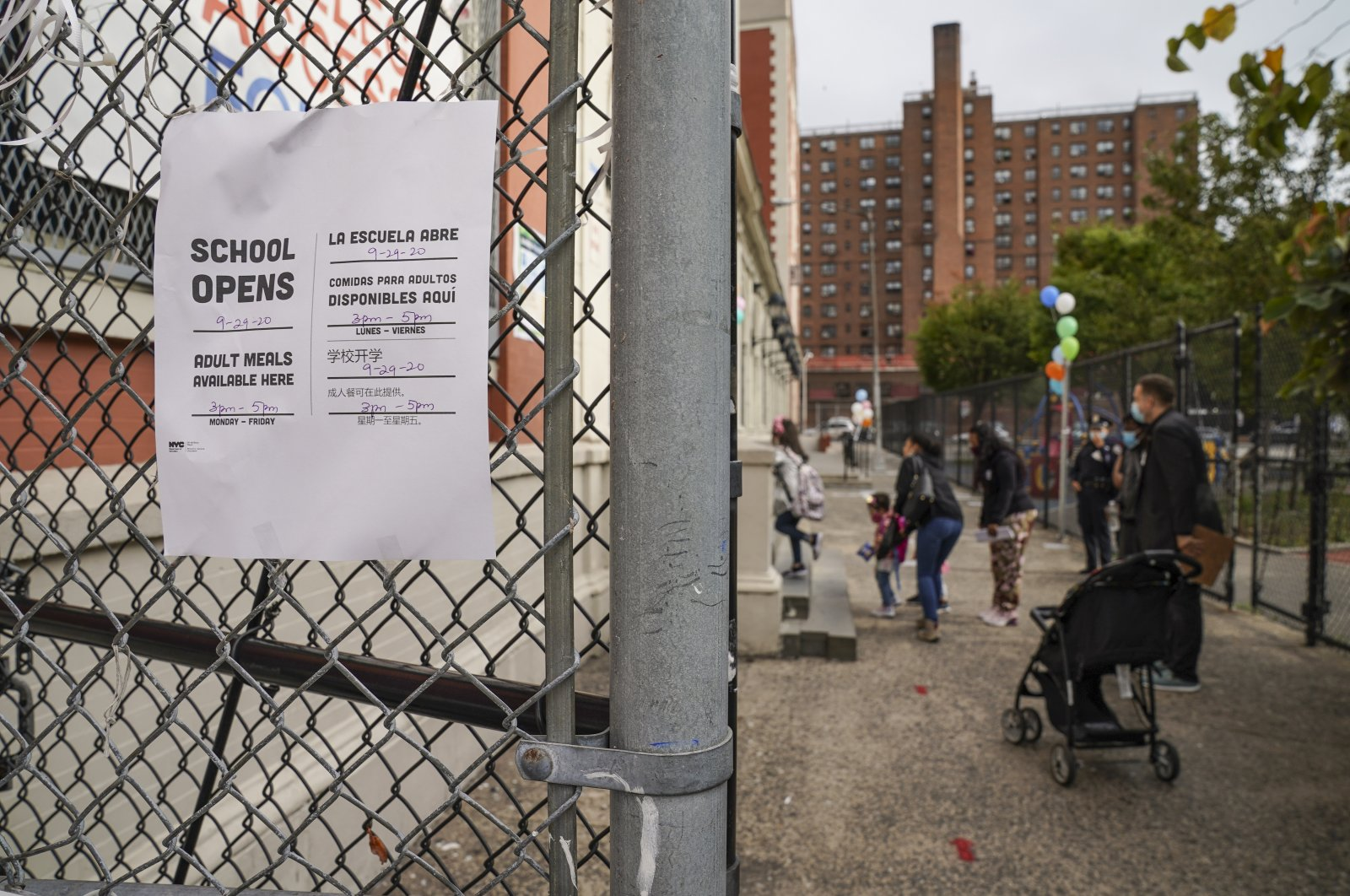 Students arrive for in-person classes outside the Public School 188 The Island School, in the Manhattan borough of New York, U.S., Sept. 29, 2020. (AP Photo)