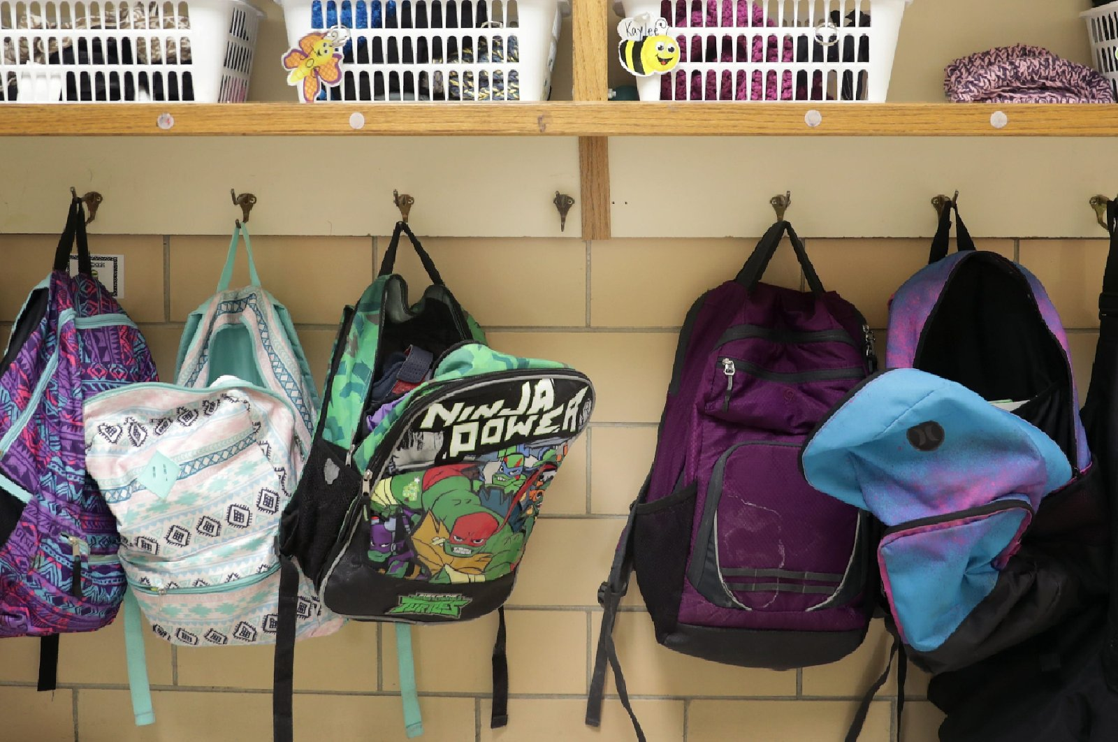 Colorful backpacks hang on a coat rack at Lincoln Elementary School, in Appleton, Wisconsin, U.S., Feb. 4, 2020. (Reuters File Photo)