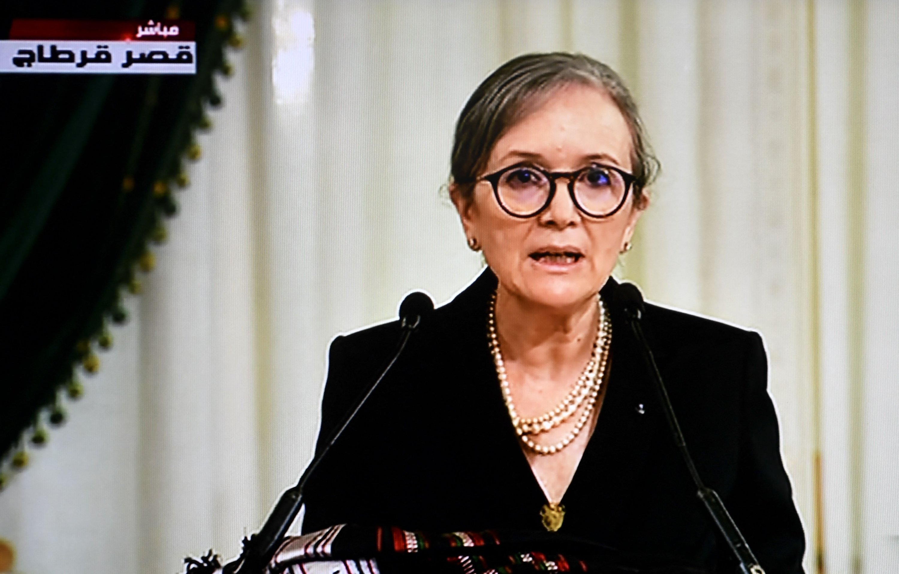 A screengrab shows Tunisia's national television broadcast of Prime Minister Najla Bouden announcing the formation of a new government at the Carthage Palace, Tunis, Tunisia, Oct. 11, 2021. (AFP Photo)