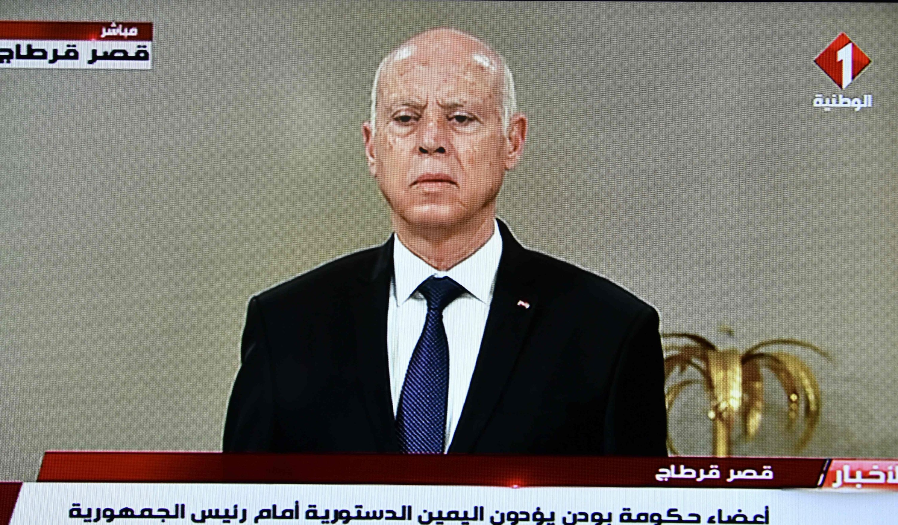 A screengrab shows Tunisia's national television broadcast of President Kais Saied announcing the formation of a new government at the Carthage Palace, Tunis, Tunisia, Oct. 11, 2021. (AFP Photo)