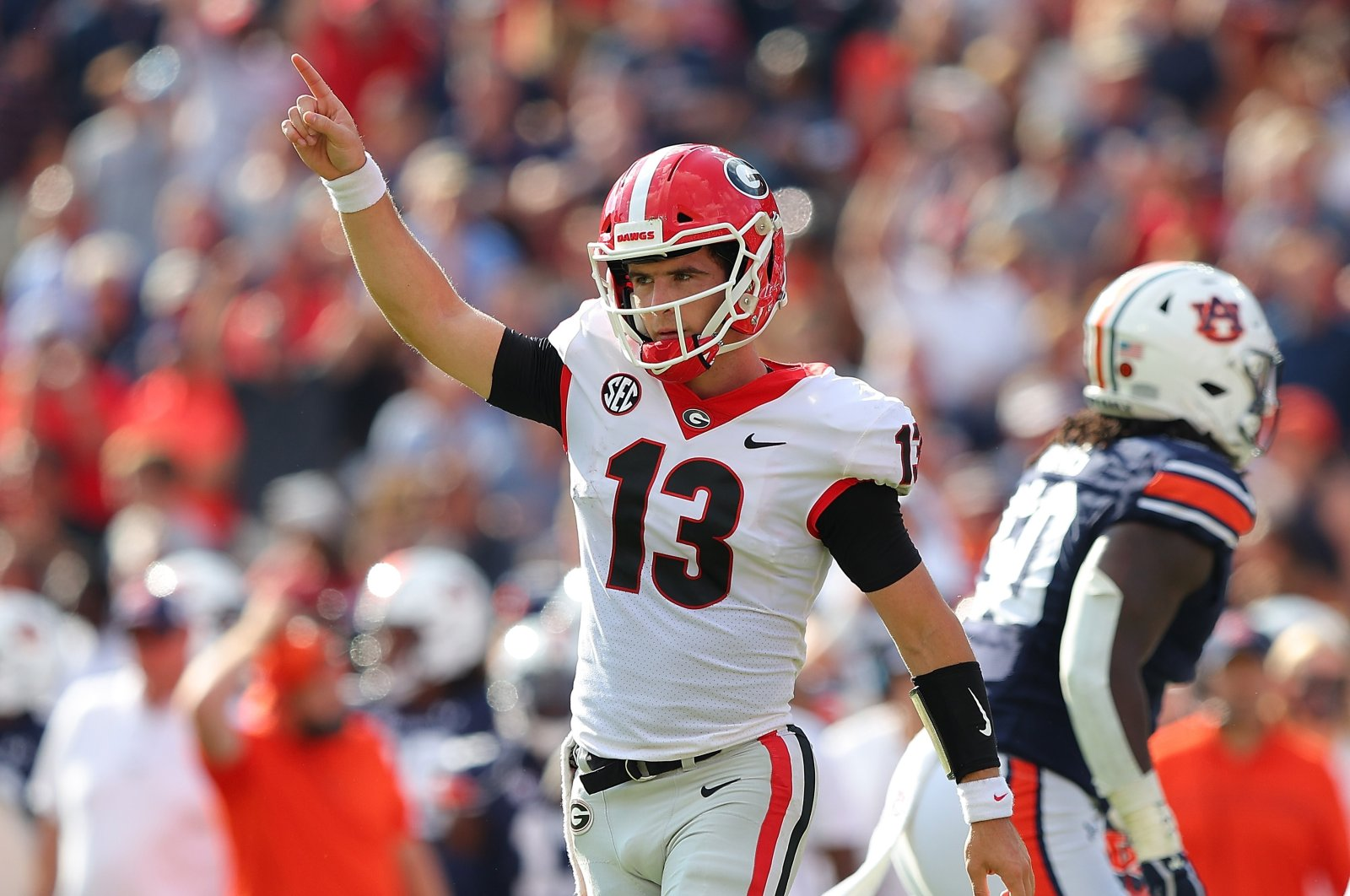 Stetson Bennett (13) of the Georgia Bulldogs reacts after a touchdown against the Auburn Tigers during the first half at Jordan-Hare Stadium, Auburn, Alabama, U.S., Oct. 9, 2021.(AFP Photo)