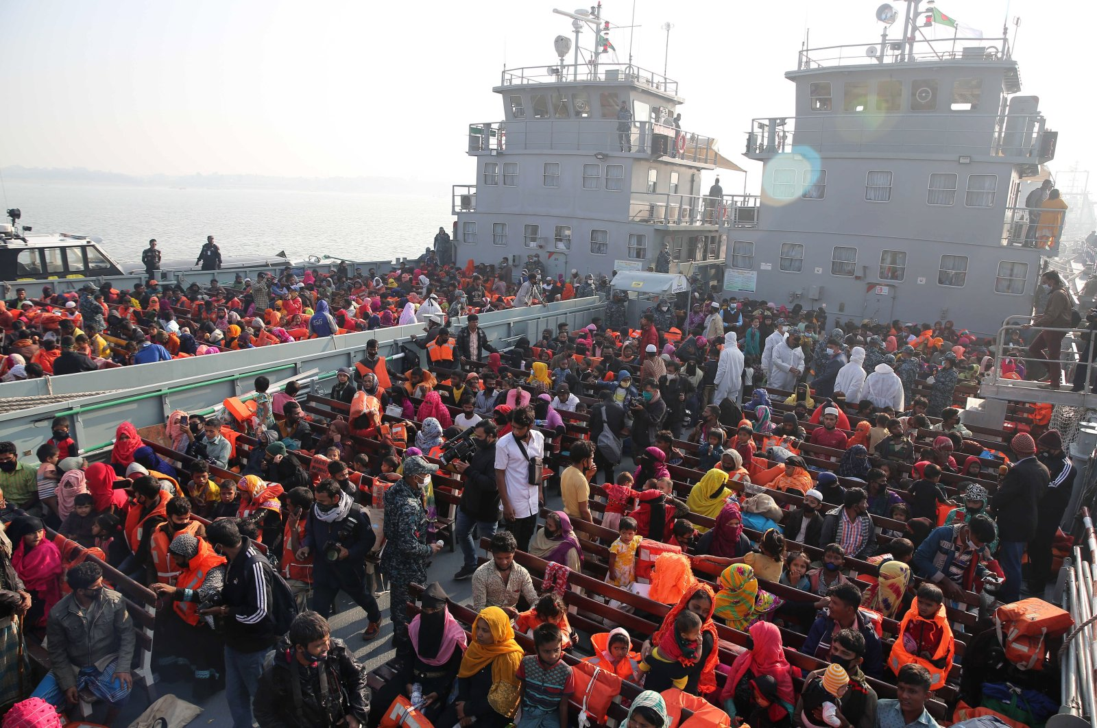 Rohingya refugees wait on naval ships to be transported to an isolated island in the Bay of Bengal, in Chittagong, Bangladesh, Dec. 29, 2020. (AP Photo)