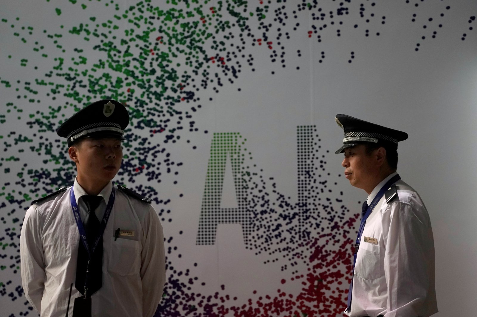 Security officers keep watch in front of an AI (Artificial Intelligence) sign at the annual Huawei Connect event in Shanghai, China, Sept. 18, 2019. (Reuters Photo)