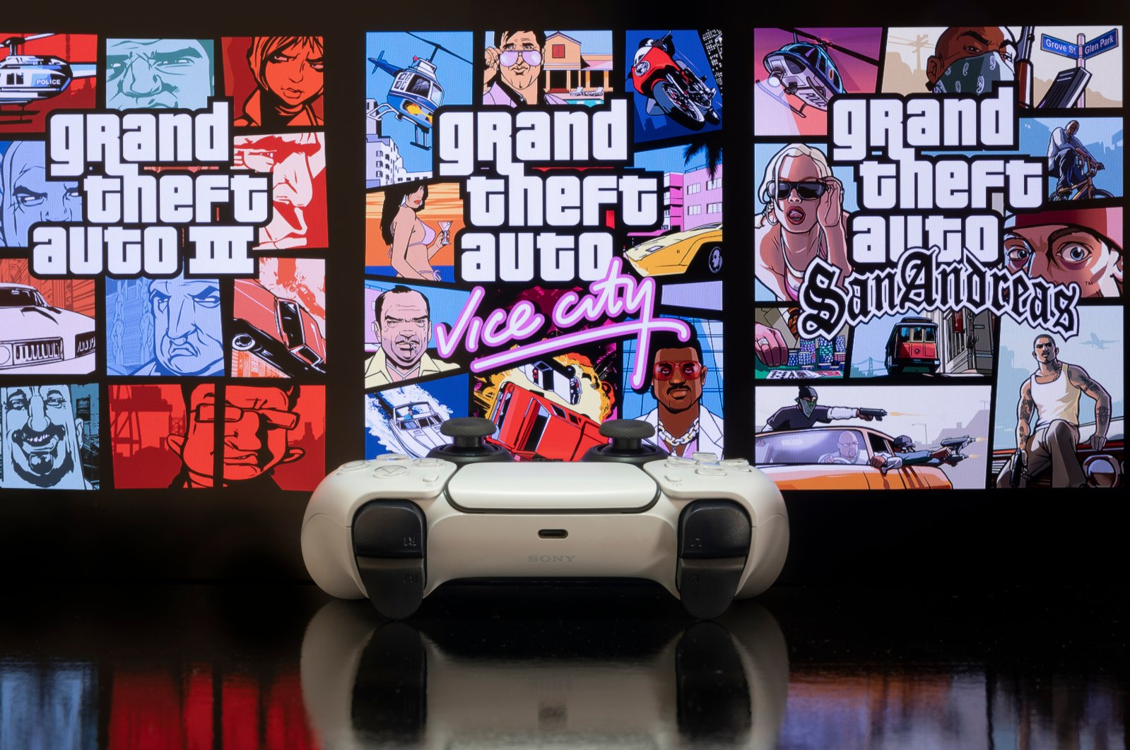 GTA: The Trilogy Definitive Edition - III, Vice City and San Andreas - on a TV screen with Playstation 5 game controller. (Shutterstock Photo)