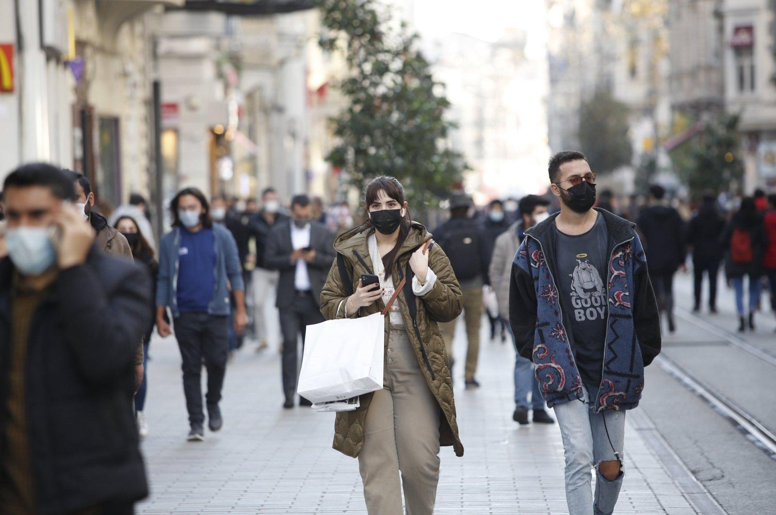 People walk down the popular shopping destination, Istiklal Avenue, in Istanbul, Turkey, Dec. 13, 2020. (Photo by Murat Şengül)