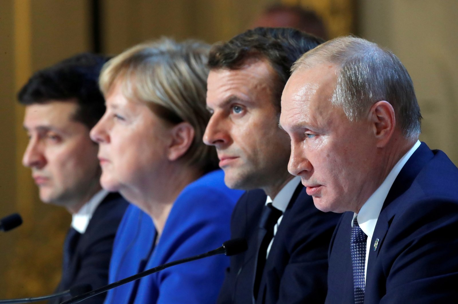 From left to right, Ukraine's President Volodymyr Zelenskyy, German Chancellor Angela Merkel, French President Emmanuel Macron and Russia's President Vladimir Putin attend a joint news conference after a Normandy-format summit in Paris, France, Dec. 9, 2019. (Reuters Photo)