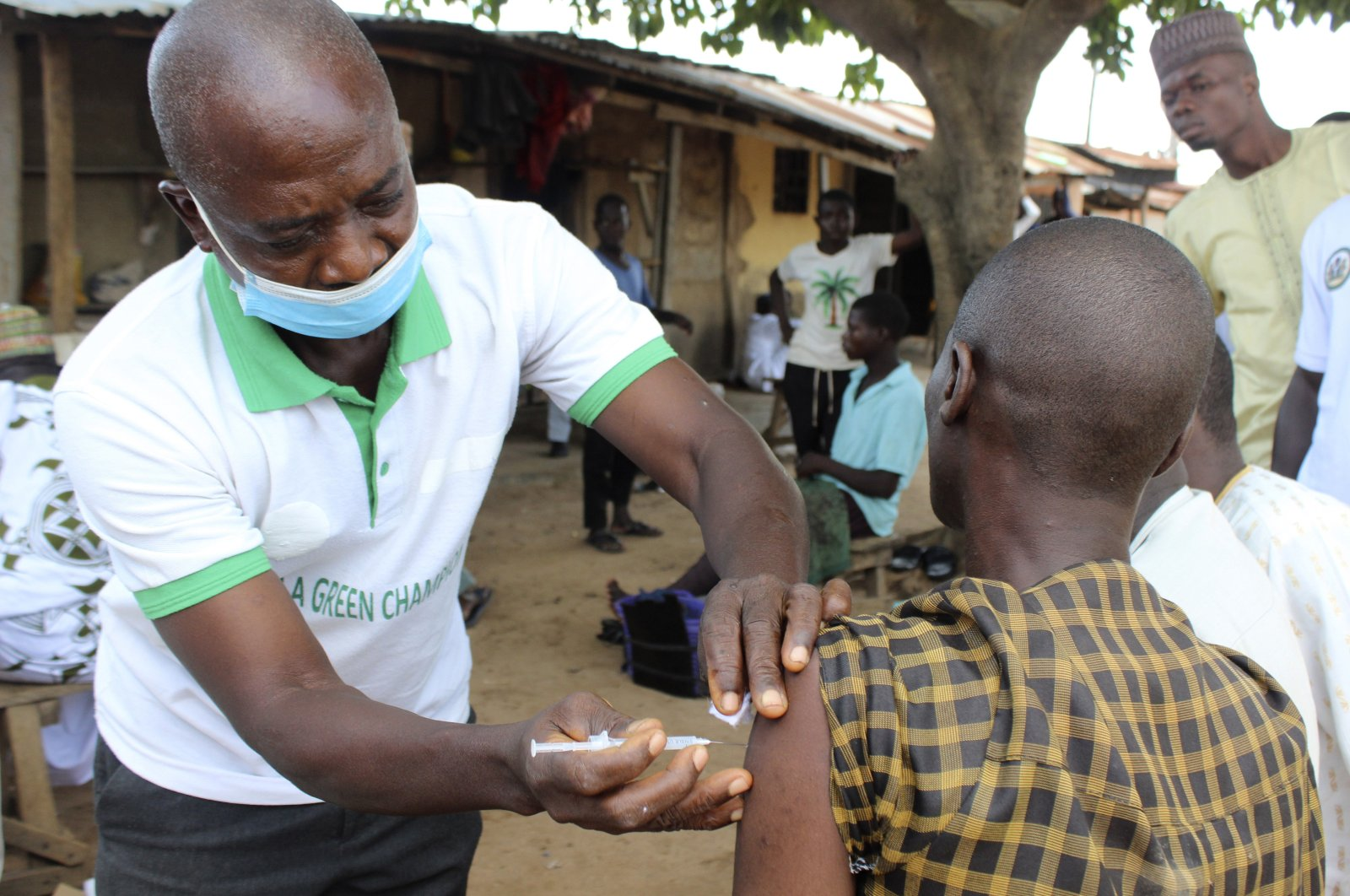 A Muslim man is administered a Moderna COVID-19 vaccination outside the Kuje, Central Mosque outskirts of Abuja, Nigeria, Oct. 8, 2021. (AP Photo)