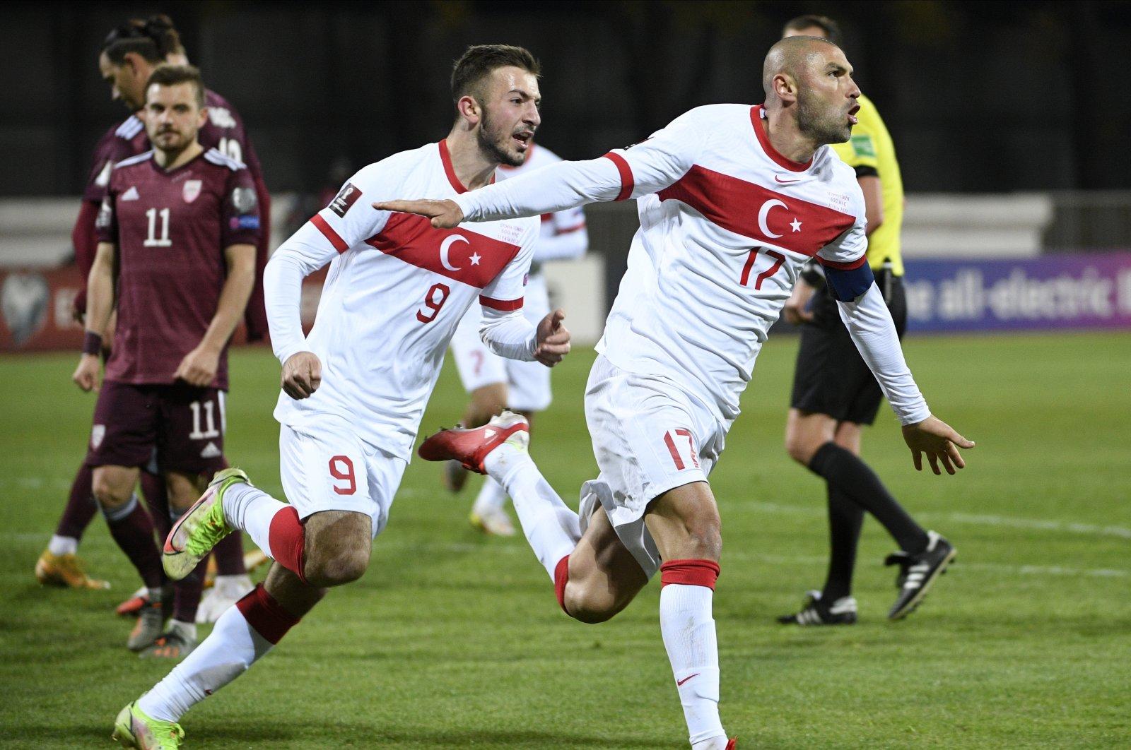 Turkey's Burak Yılmaz (R) celebrates a goal during the FIFA World Cup Qatar 2022 Group G qualifying football match between Latvia and Turkey at the Daugava Stadium in Riga, Latvia, Oct. 11, 2021. (AP Photo)
