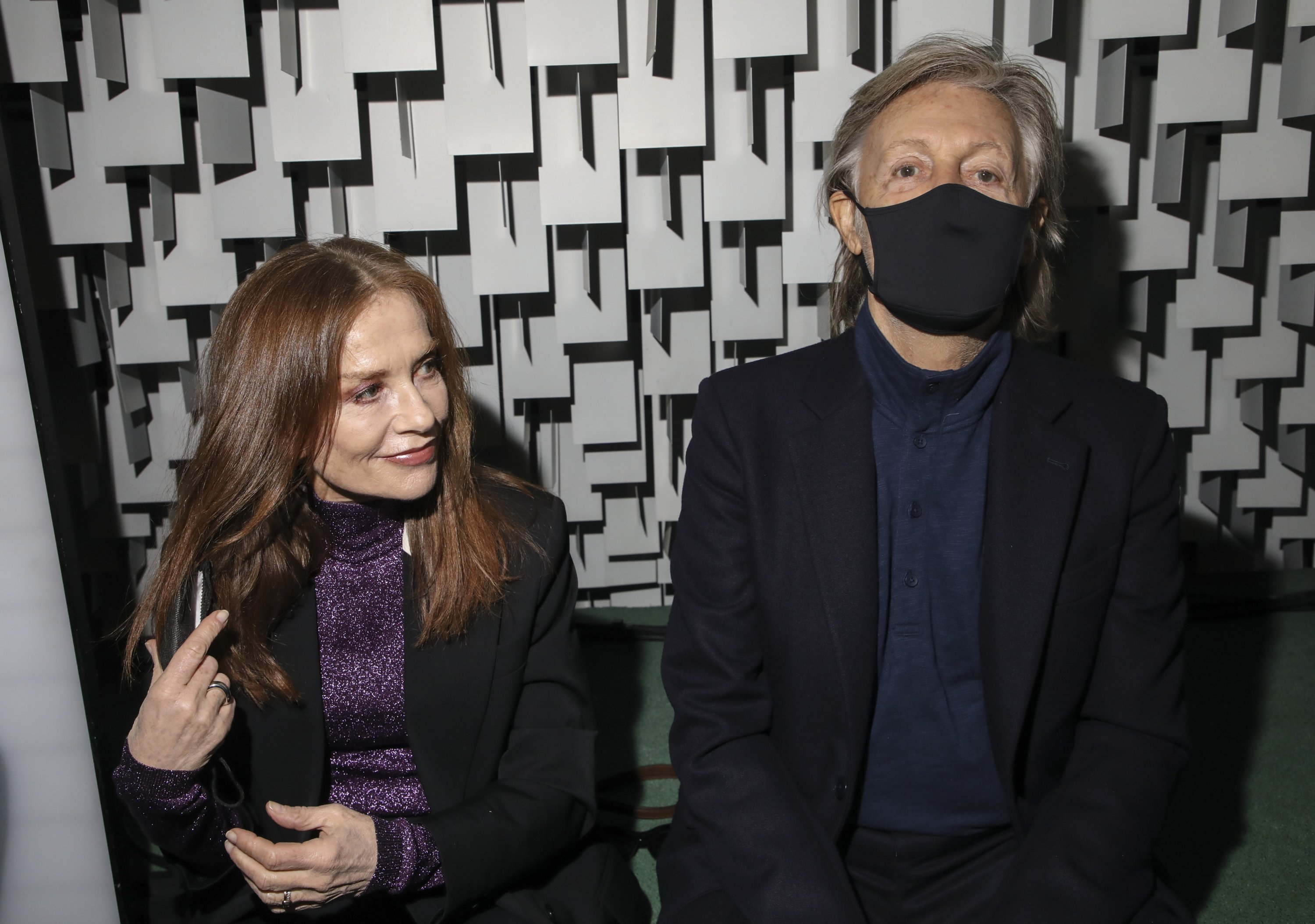 Isabelle Huppert (L) and Paul McCartney attend the Stella McCartney Spring-Summer 2022 ready-to-wear fashion show presented in Paris, France, Oct. 4, 2021. (AP Photo)