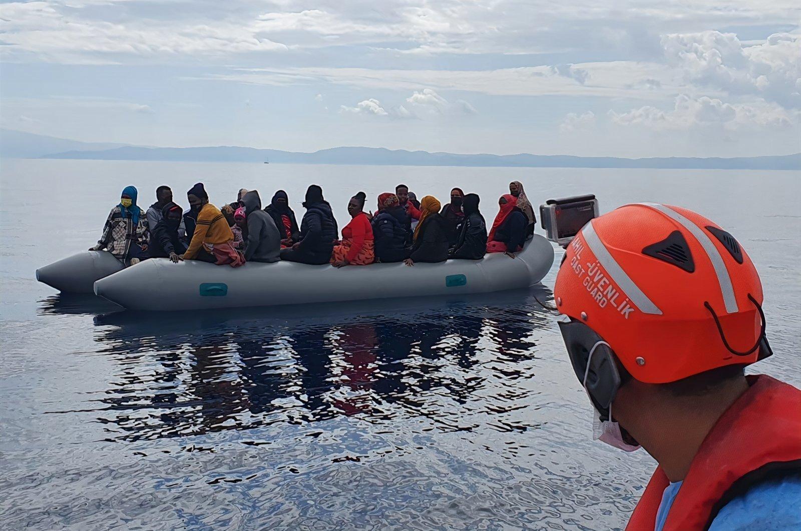 Turkish coast guard rescues irregular migrants pushed back by Greece off the coast of Dikili, Izmir, southwestern Turkey, Oct.11, 2021 (DHA Photo)