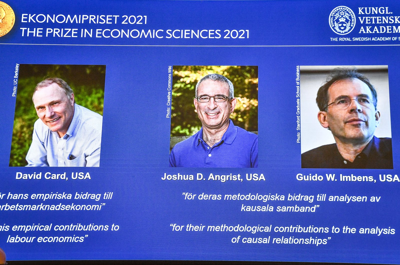 (L-R) David Card, University of California, Berkeley, U.S., Joshua D. Angrist, Massachusetts Institute of Technology, Cambridge, U.S. and Guido W. Imbens, Stanford University, U.S., seen on a screen during the announcement of the Sveriges Riksbank Prize in Economic Sciences in Memory of Alfred Nobel 2021, during a press conference at the Royal Swedish Academy of Sciences in Stockholm, Sweden, Oct. 11, 2021. (EPA-EFE Photo)
