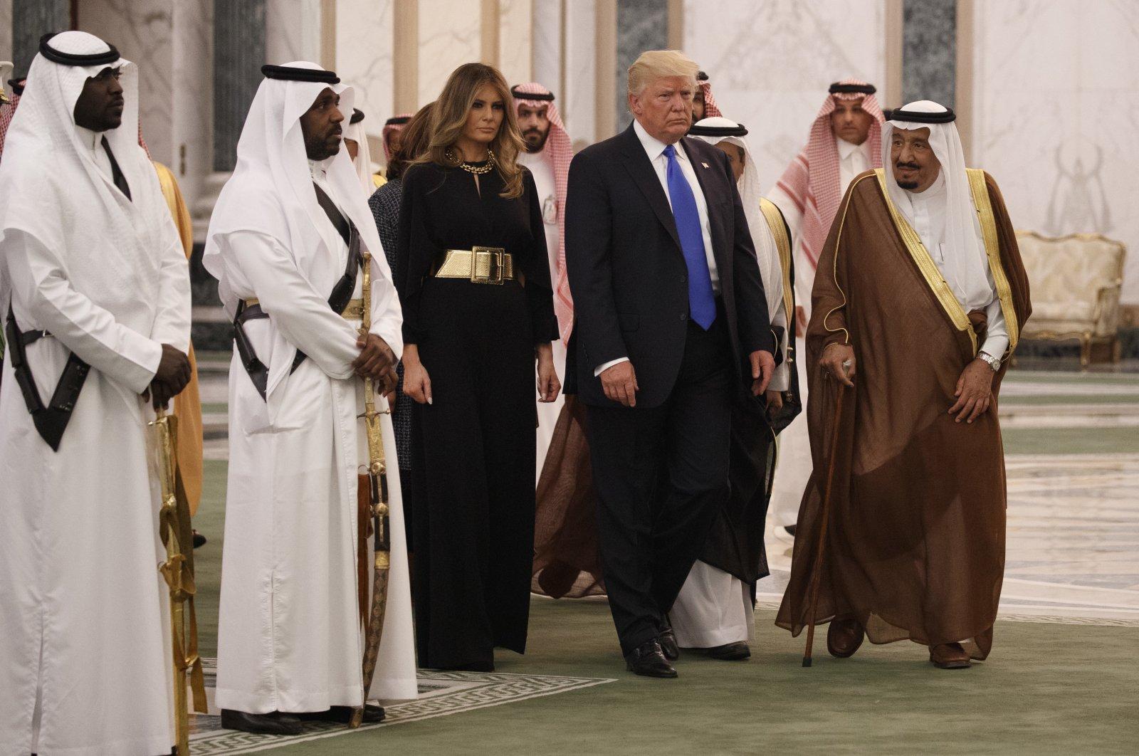 Former U.S. President Donald Trump and first lady Melania Trump walk with Saudi King Salman to a coffee ceremony and presentation ceremony of the Collar of Abdulaziz Al Saud Medal at the Royal Court Palace in Riyadh, Saudi Arabia, May 20, 2017. (AP Photo)