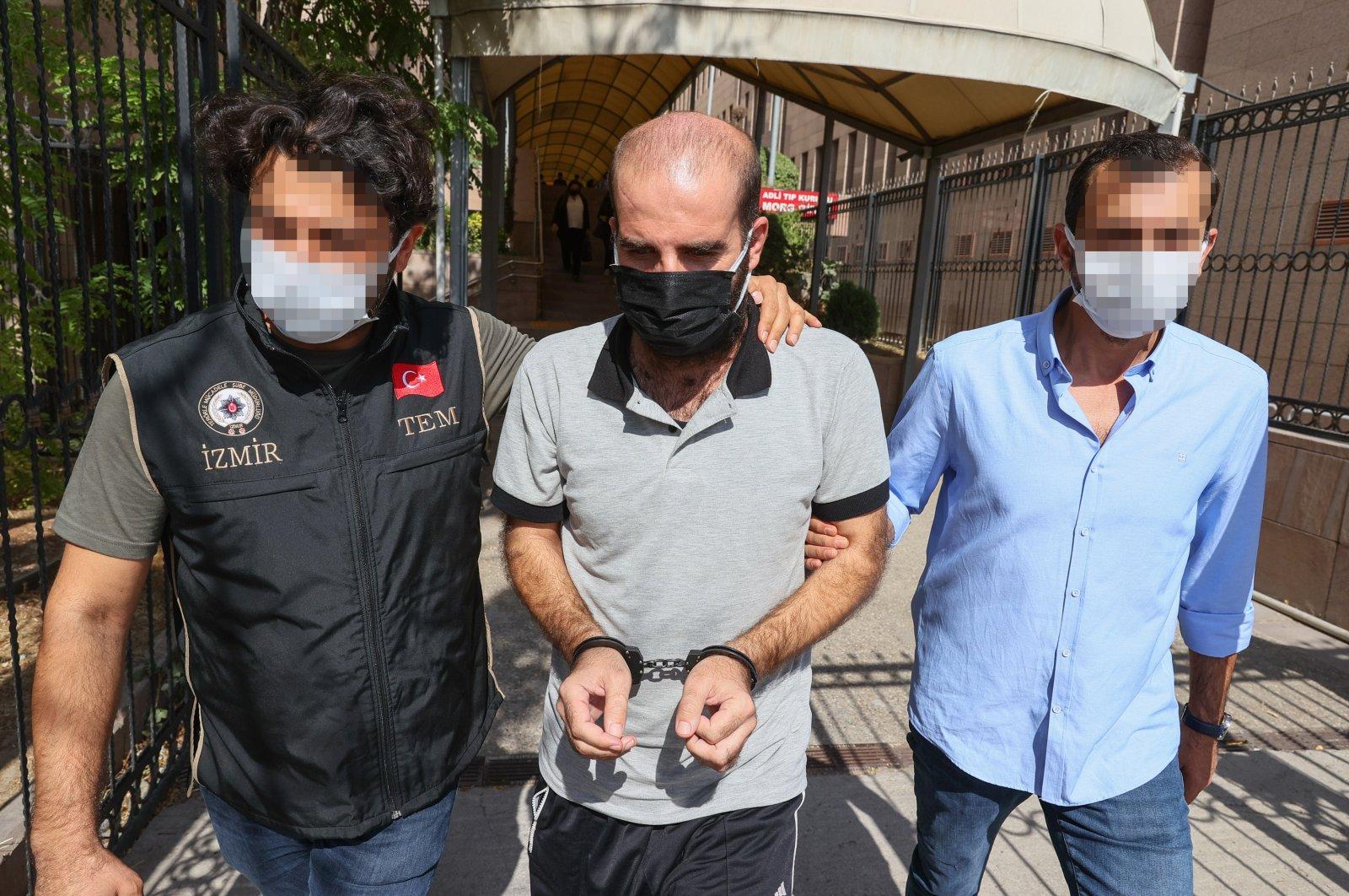Police escort PKK terrorist Delil Hıso in Izmir, Turkey, Oct. 11, 2021. (AA Photo)