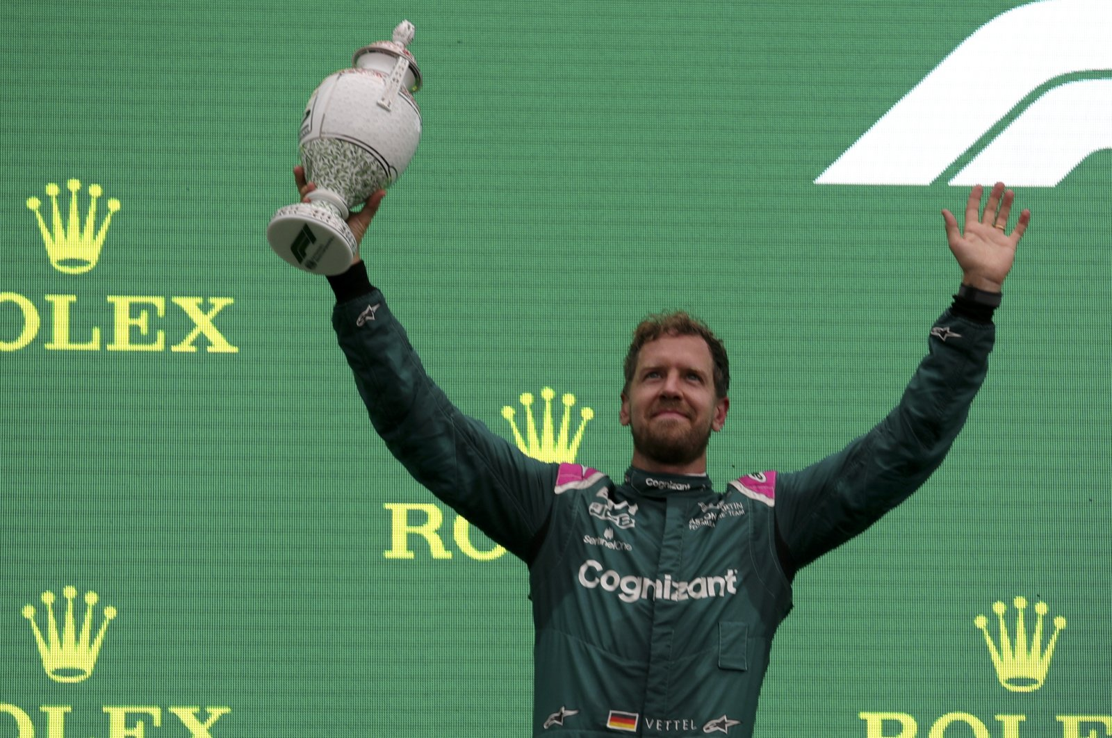 Aston Martin driver Sebastian Vettel holds up his trophy after placing second after the F1 Hungarian GP at the Hungaroring racetrack in Mogyorod, Hungary, Aug. 1, 2021. (AP PHoto)
