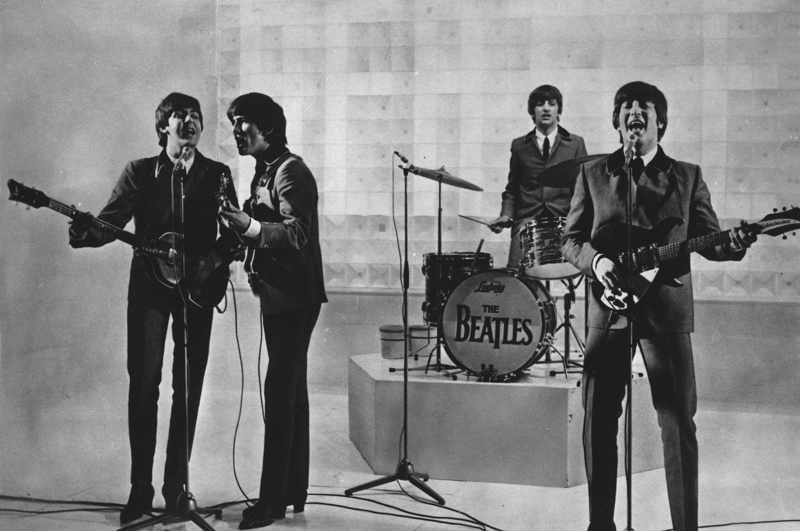 The Beatles, from left to right, Paul McCartney, George Harrison, Ringo Starr and John Lennon, are seen performing. (AP Photo)