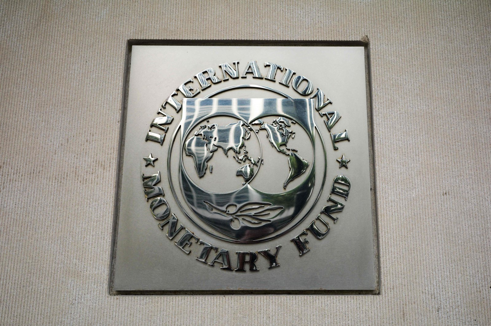 The seal of the International Monetary Fund (IMF) is seen outside of its headquarters in Washington, D.C., U.S., Oct. 7, 2021. (AFP Photo)
