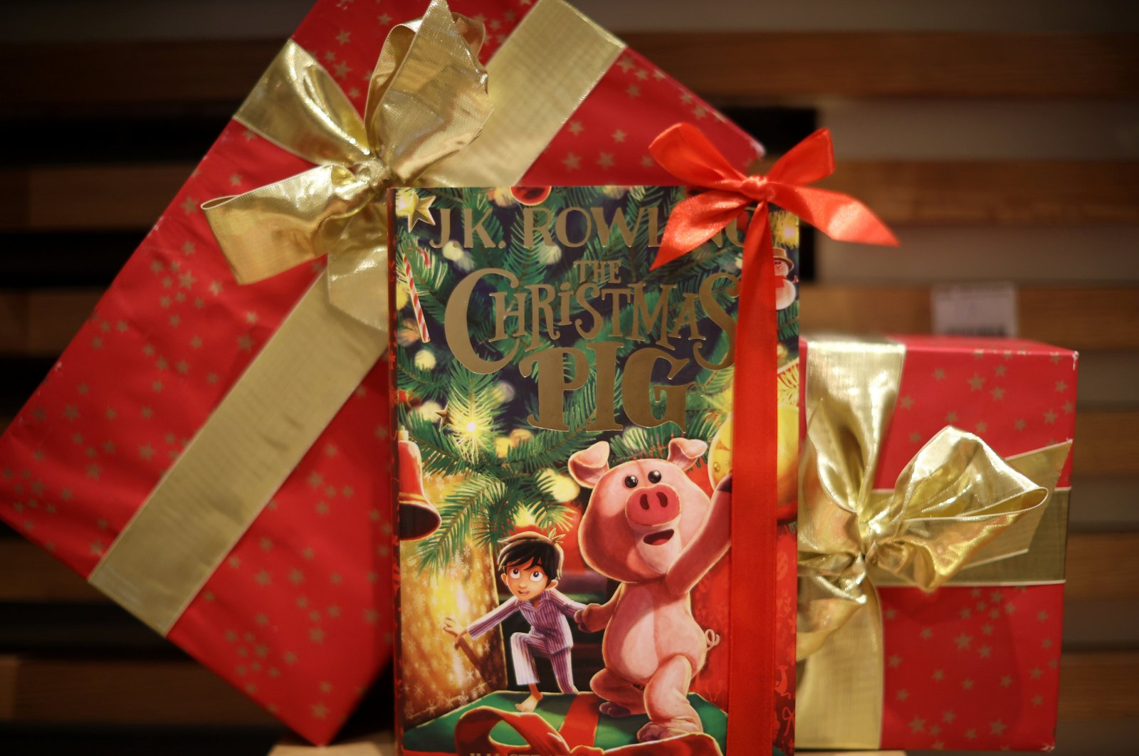"""A copy of """"The Christmas Pig,"""" a children's book written by J. K. Rowling, is displayed at a Waterstones store in London, England, Oct. 12, 2021. (REUTERS Photo)"""