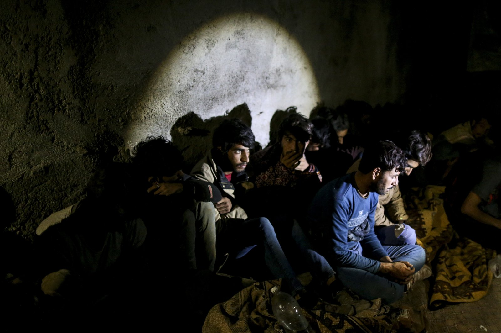 Turkish security forces apprehend a group of irregular migrants in an operation aimed at stemming the recent influx of migration, mainly coming from Afghanistan and stopping human trafficking operations in the area at the border province of Van, eastern Turkey, Aug. 21, 2021. (AP Photo)