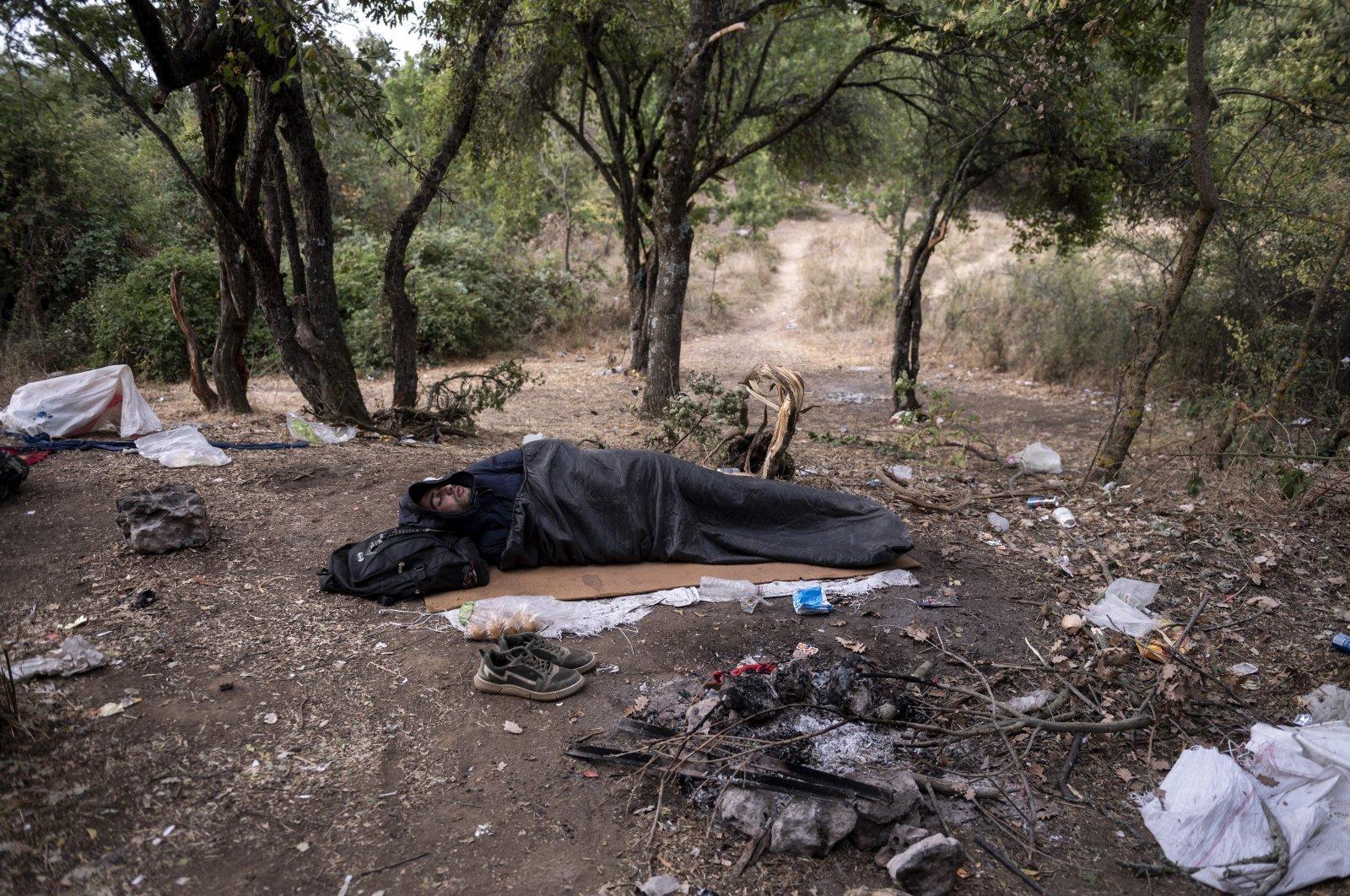 A Syrian migrant sleeps inside a forest near Ieropigi village, northern Greece, Sept. 28, 2021. (AP Photo)