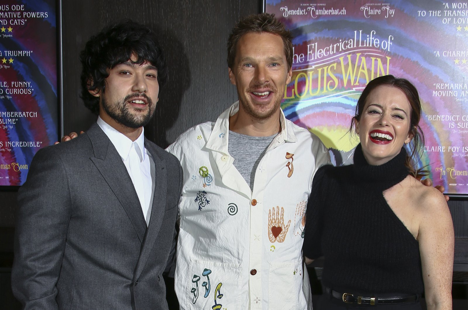 """(L-R) Will Sharpe, Benedict Cumberbatch and Claire Foy pose for photographers at the photocall for the film """"The Electrical Life of Louis Wain"""" in London, Oct. 10, 2021. (AP Photo)"""