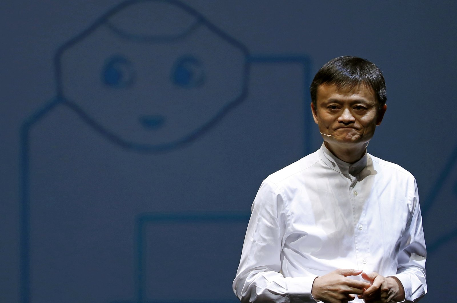 """Jack Ma, founder and executive chairperson of China's Alibaba Group, speaks in front of a picture of SoftBank's human-like robot named """"Pepper"""" during a news conference in Chiba, Japan, June 18, 2015. (Reuters Photo)"""