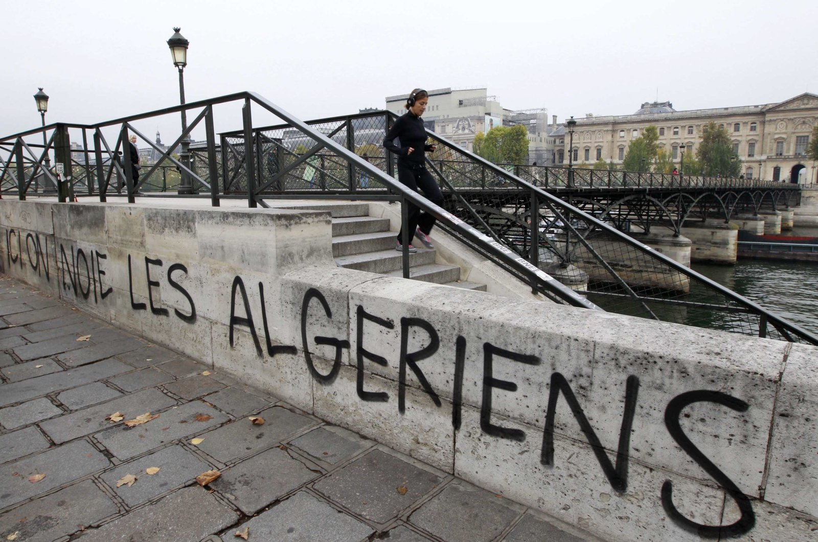 """A slogan """"We drown Algerians here"""" is painted on the wall of the Seine River banks near the Pont des Arts in Paris, France, Oct. 17, 2011. (Reuters Photo)"""