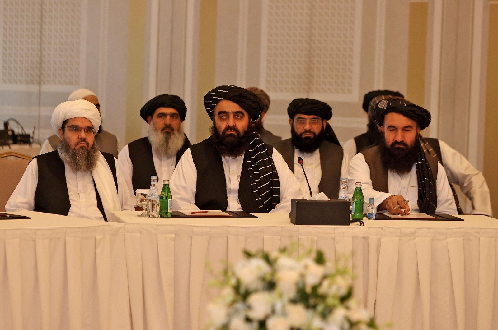 Members of the Taliban delegation Shahabuddin Delawar (L), Amir Khan Muttaqi, and Khairullah Khairkhwa (R) meet with foreign diplomats in Qatar's capital Doha, on Oct.12, 2021. (AFP Photo)