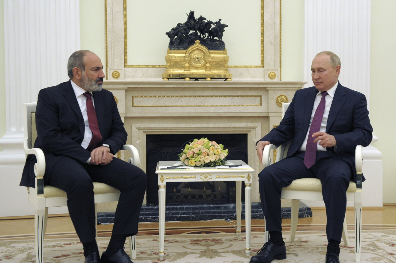 Russian President Vladimir Putin (R) and Prime Minister of Armenia Nikol Pashinian speak during their meeting in Moscow, Russia, Oct. 12, 2021. (AP Photo)