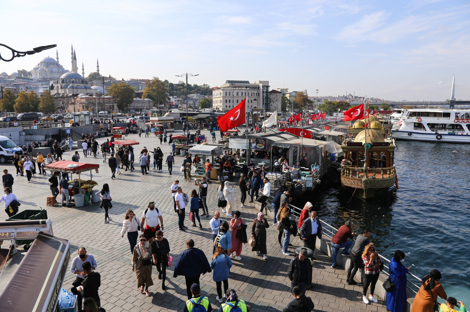 People seen walking and spending time on a sunny day in Eminönü, Istanbul, Turkey, Oct. 11, 2021. (Photo by Getty Images)