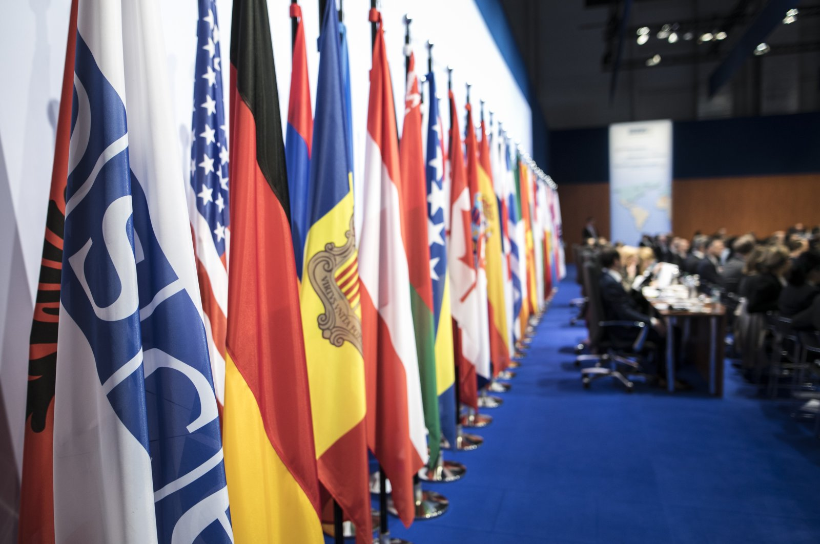 Flags stand in the plenary room of the OSCE Ministerial Council in Hamburg, Germany, Dec. 8, 2016. (Getty Images)