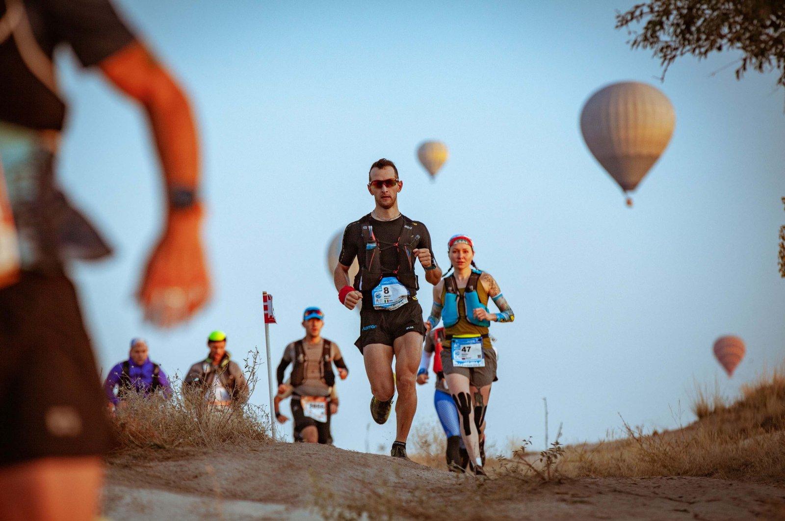 Athletes compete in the Salomon Cappadocia Ultra-Trail held in Nevşehir, Turkey, Oct. 19, 2019. (IHA Photo)