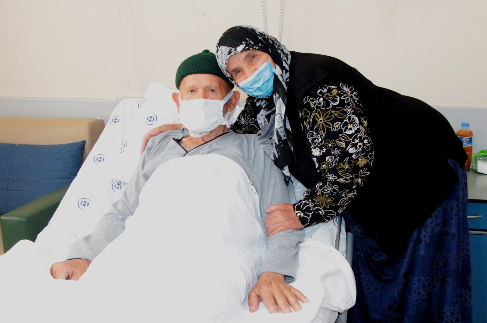The 80-year-old Ali Öküzcü (L) who beat COVID-19 and cancer with the support of his wife Yeter Öküzcü, Adana, Turkey, Oct. 12, 2021. (DHA Photo)